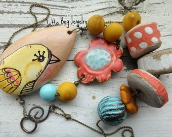 Twiddle-Dee-Dee- hand painted wooden yellow bird pendant. yellow turquoise orange coral pink. earthy boho wood necklace. Jettabugjewelry