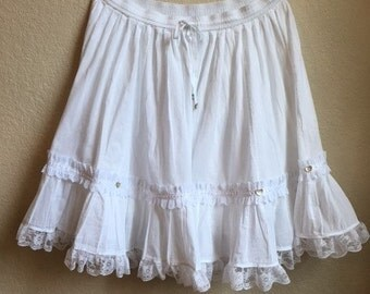 White skirt with lace and heart shaped buttons