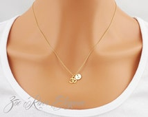 Tiny silver or gold Om necklace Simple and elegant