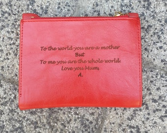 leather monogrammed clutch