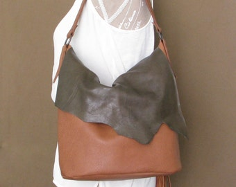 Leather zipped bucket bag with irregular flap