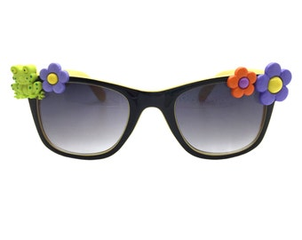 Women's Black and Yellow Sunglasses with Hand-Applied Green Frog and Multi-Color Flower Embellishments. 100% UV Protection