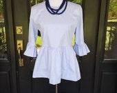 The Carolina top women's peplum top shown in blue chambray custom made by Collyn Raye fall fashion
