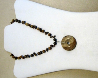 Brown beaded necklace with stone disk pendant