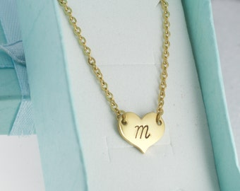 Heart necklace in gold stainless steel and personalized by hand stamping an initial of your choice.  Heart necklace. Hand stamped.