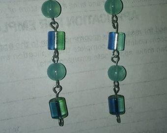 Transparent blue dangle earrings