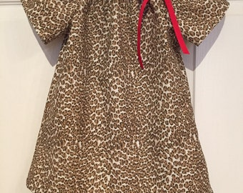 Peasant dress size 18-24 months.  Infant dress and girl toddler dress in animal print.  Other sizes upon request.