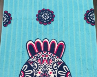 Appliqued owls on a turquoise blue beach towel.