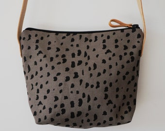 Small shoulder bag with hand-printed pebbles design