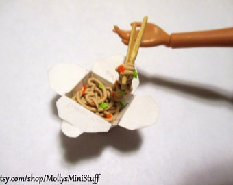Miniature dollhouse scale sculpture of Chinese take out with noddles and vegetables with small chopsticks made of polymer clay