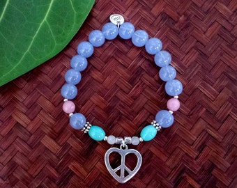 Love & Peace bracelet - Beaded stretch bracelet in pastel colours with love and peace charm