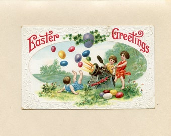 Vintage Easter Postcard Children Firing Colored Easter Eggs From Cannon Embossed Used North Groton NH Amy Duncklee Plymouth NH - 5908Pa