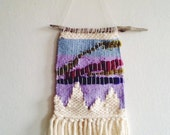 Northern Lights Woven Wall hanging on a branch from Lapland