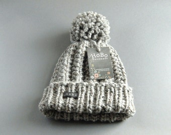 Womens Bobble Hat. Grey HoBo Handmade 'Lofty'. Thick chunky hand knitted beanie with large removable pom pom. Gray tweed wool blend. Ladies
