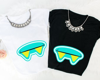 Turquoise monster mouth tees.