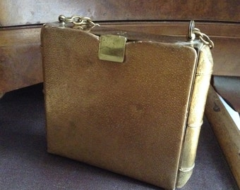 A Vintage 1930's gold coloured leather & metal evening bag, purse, handbag.