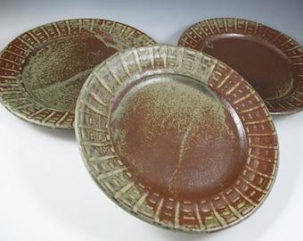Set of plates (8), wood ash glazed stoneware dinner plates with basketweave pattern on rim