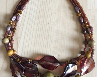 Triple tier bead necklace with acrylic leaf features