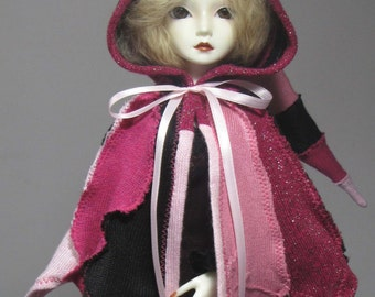 MSD capelet in pinks and black