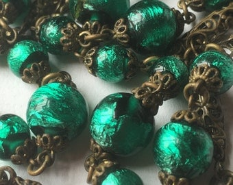 Vintage 1940s Long Necklace/Emerald Green Foil Round Glass Beads/Prolonged open-work Metal Beads/Old Gold tone Metal