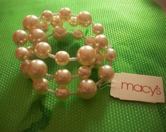 Pearl wrapped                                   bracelet & newer worn