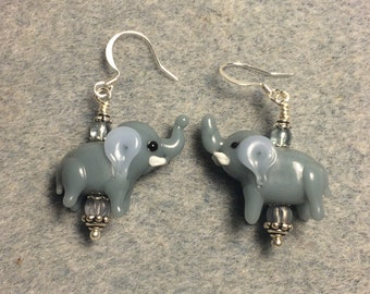 Opaque blue grey lampwork elephant bead earrings adorned with blue grey Czech glass beads.