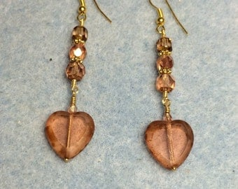 Peach glass heart dangle earrings adorned with peach Czech glass beads.