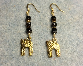 Gold cat charm dangle earrings adorned with black Czech glass beads.