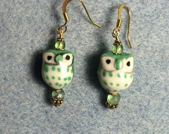 Green ceramic owl bead earrings adorned with green Czech glass beads.