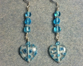 Turquoise and clear millefiori heart bead dangle earrings adorned with turquoise Czech glass beads.