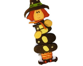 """Halloween """"BOO"""" Whitch wooden decrative piece. This child like whitch has tons of personality. Narrow/ top to bottom hanger make it ideal."""