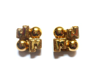 PACO RABANNE Earring clips . Gold tone metal . Monogram Signature Logo . Jewelry . Vintage 1980s