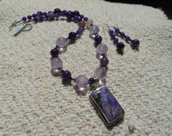 Purple Passion.....if purple is your passion then this necklace is for you and unique is the bonus.  Charolite and amethyst are the gems.