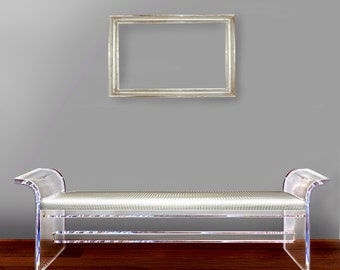 Lucite bench made of thick acrylic and silver color of the upholstery