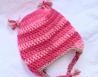 Pink earflap beanie with plaits and tan trim