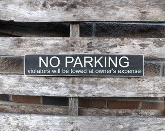 No Parking violators will be towed at owner's expense, Parking signs