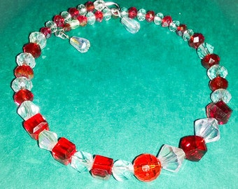 Beautiful red and clear crystals wire bracelet! Fits all wrists.