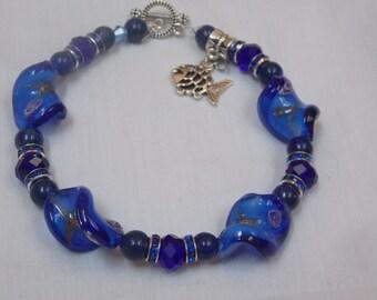 Beaded Bracelet,hand made w/lapis w/ fish
