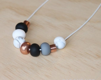 "Polymer clay bead necklace. Marble, copper, grey, black, white and copper metal beads! ""the bella"" 9 beads"