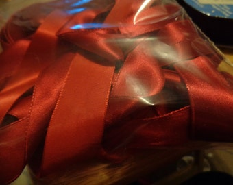 3 pieces of various width red satin ribbon