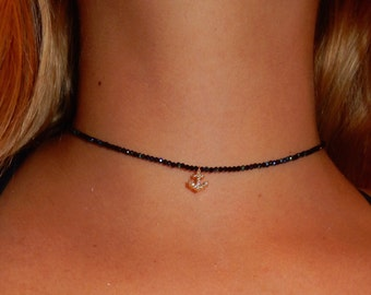 choker with little sail pendent