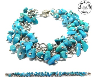 Charm bracelet chain of a silver colour with 59 natural tumbled turquoises and an easy-to-fasten magnetic clasp (#43)