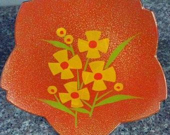 70's Retro orange plate with daisy