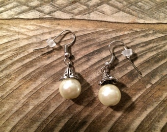 Peal and silver earrings.