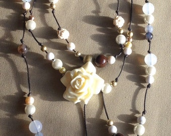 Brown cord and beaded rose necklace