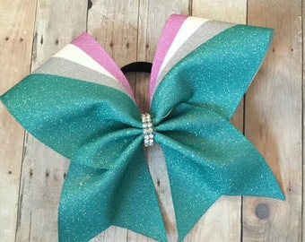 Beautiful custom 4 color big cheer bow with rhinestone center   Teal bow with pink, silver, and white accents  Create in any color combo