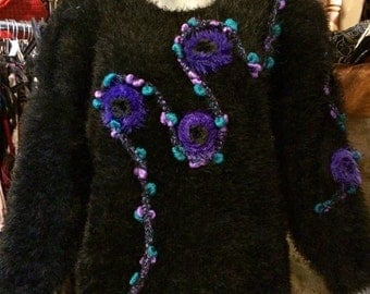 Over 1980's hairy pullover, with huge shoulder pads. Size S.