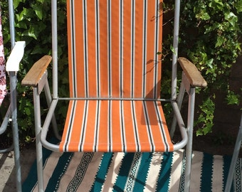 Vintage retro orange deck chair deckchair