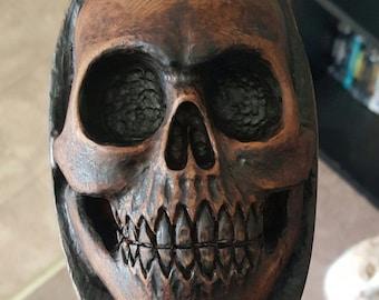 Hand carved wood skull