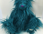 July, a traditionally jointed collectors bear, shaggy turquoise fur. Part of the Calendar Bears Collection. Pyjama Bears.